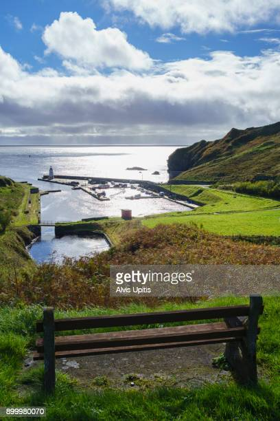Bench overlooking Lybster Harbor in Scottish Highlands