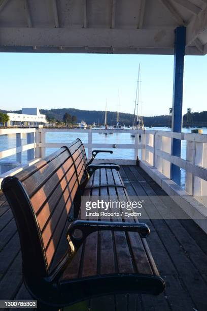 bench seat on wharf early morning - batemans bay stock pictures, royalty-free photos & images