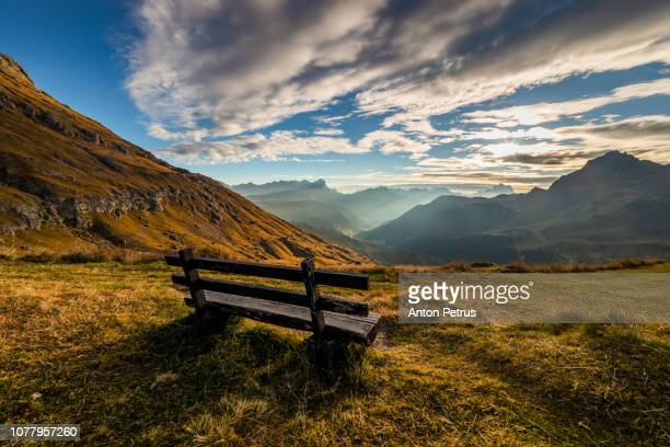 Bench with a beautiful view at sunrise at Pass Pordoi. Dolomites mountains, Italia.