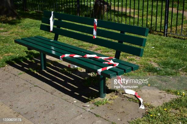 bench with caution warning tape, london, england - park bench stock pictures, royalty-free photos & images