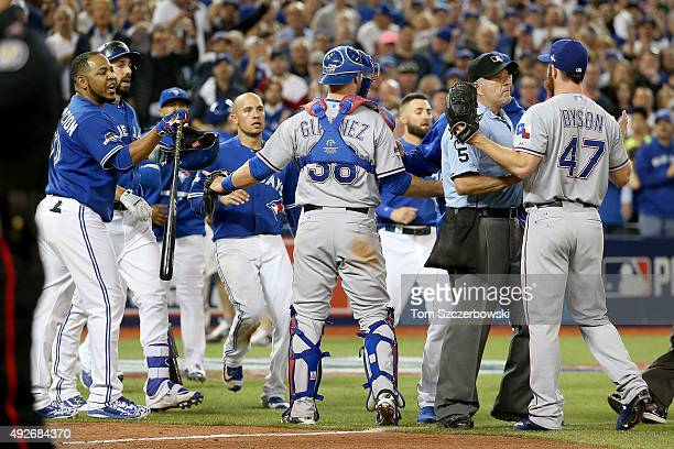 Benches clear in the seventh inning as Edwin Encarnacion of the Toronto Blue Jays and Sam Dyson of the Texas Rangers argue in game five of the...
