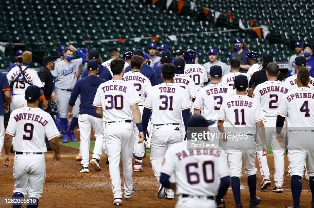 Benches empty out after Joe Kelly of the Los Angeles Dodgers threw several high inside pitches to Alex Bregman of the Houston Astros, Yuli Gurriel...