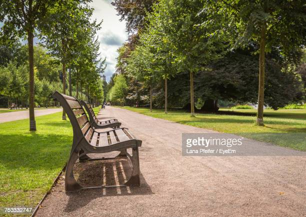 Benches In Park Against Sky
