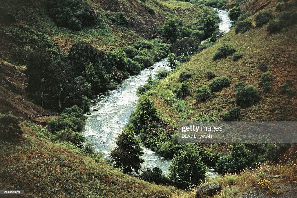Bend of River Jordan amongst vegetation, Israel : News Photo