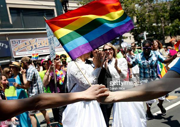 Bend the Arc a Jewish social justice group dances around two women dressed as brides during the 43rd annual San Francisco Lesbian Gay Bisexual...