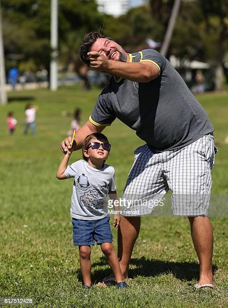 Bendeguz Orosz and his father Tamas Orosz of Boca Raton Fla fly their kite during the 24th annual Kitetoberfest kite festival on Sunday Oct 23 2016...