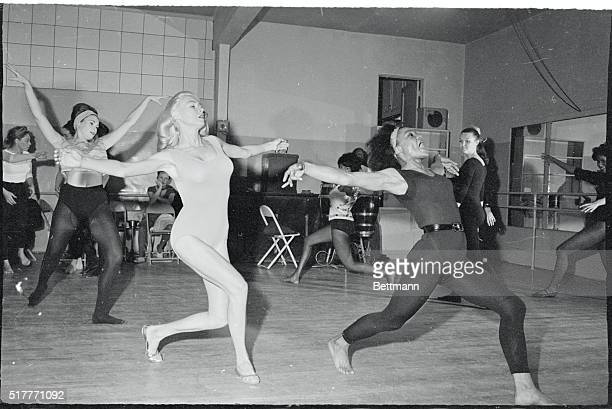 Bending over with enthusiasm shapely Les Femmes look toward Eartha Kitt for further instructions during a dance lesson The singing and dancing star...