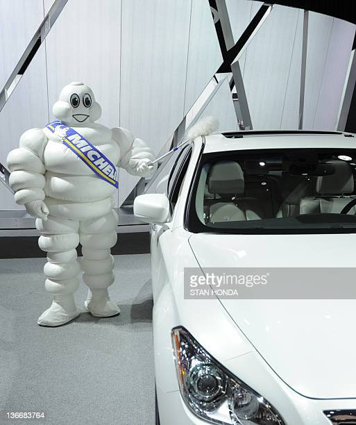Bendo The Michelin Man dusts the Infiniti M56X during the press preview day at the 2012 North American International Auto Show January 10 2012 in...