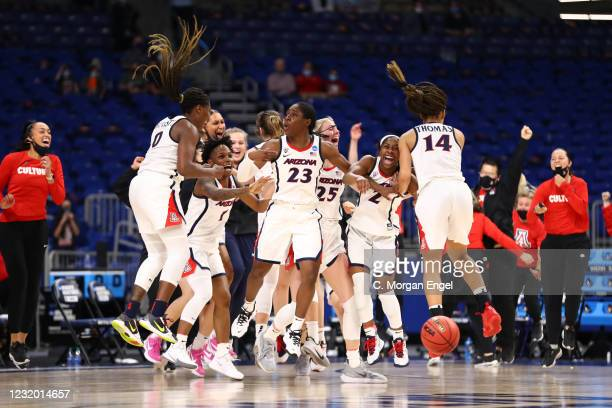 Bendu Yeaney of the Arizona Wildcats and her teammates celebrate a victory against Indiana Hoosiers in the Elite Eight round of the 2021 NCAA Women's...