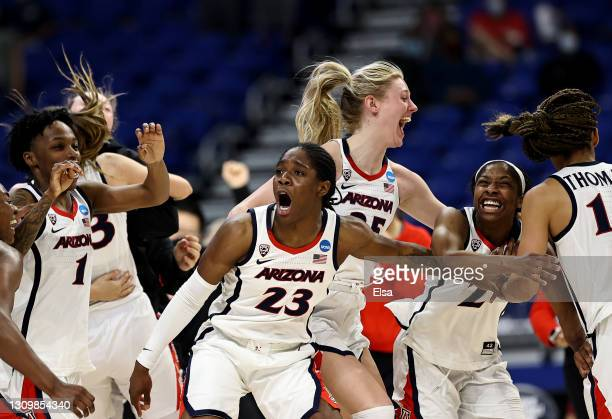 Bendu Yeaney of the Arizona Wildcats and the rest of the Arizona Wildcats celebrate the win over Indiana Hoosiers during the Elite Eight round of the...