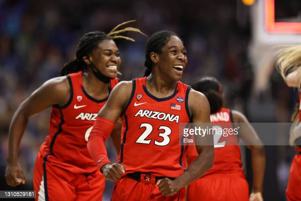Bendu Yeaney of the Arizona Wildcats celebrates with teammates after defeating the UConn Huskies during the fourth quarter in the Final Four...