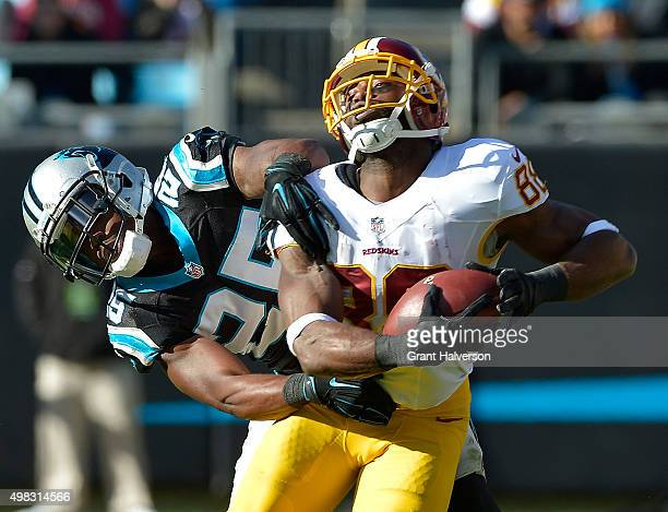 Bene' Benwikere of the Carolina Panthers defends a pass to Pierre Garcon of the Washington Redskins during their game at Bank of America Stadium on...