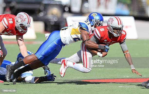 Bene Benwikere of the San Jose State Spartans sacks quarterback Caleb Herring of the UNLV Rebels during the first quarter of their game at Sam Boyd...