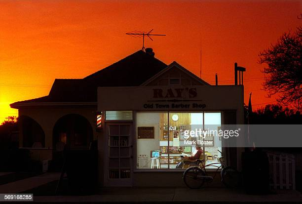 Beneath a bright orange sunset barber Roy Frietas sat quietly in his own soft chair in the window of Ray's Old Town Barber Shop that he owns with his...