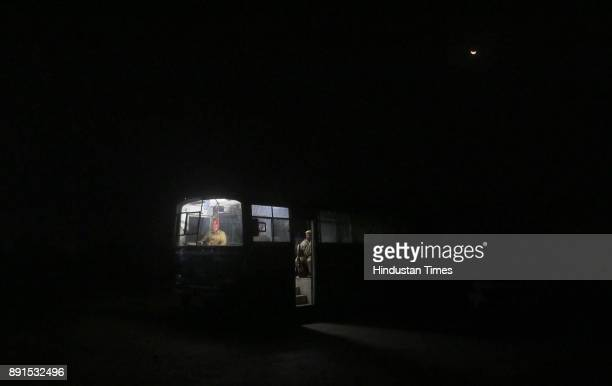 Beneath a rising moon the Police official on duty in their bus at the anticow smuggling Mobile Police Post at Amalaki at Bhiwadi on intervening night...