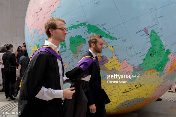 Beneath the sculpture by Turner Prizewinning artist Mark Wallinger entitled The World Turned Upside Down' new graduates straight after their...