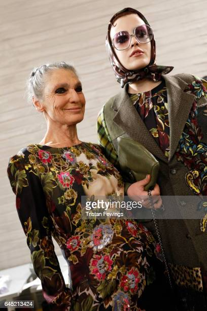 Benedetta Barzini and a model prepare backstage ahead of the Antonio Marras show during Milan Fashion Week Fall/Winter 2017/18 on February 25 2017 in...