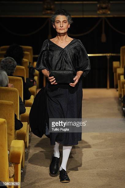 Benedetta Barzini walks down the runway at the AI_ Andrea Incontri AI_ Waiting Room fashion show held during Pitti Immagine Uomo 79 on January 13...