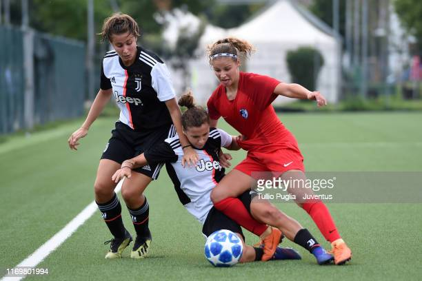 Benedetta Maino and Nicol Gianesin of Juventus compete for the ball with Anaelle Michelland of Grenoble during the friendly match between Juventus...