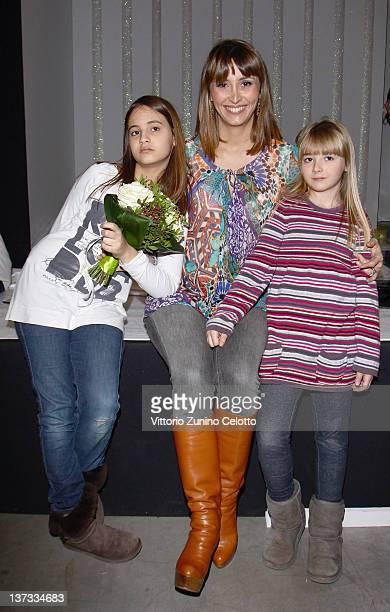 Benedetta Parodi and her daughters Eleonora and Matilde attend the Miss Blumarine fashion show as part of Pitti Immagine Bimbo 74 on January 19 2012...