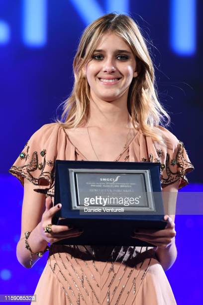 Benedetta Porcaroli poses with an award on stage at the Nastri D'Argento awards ceremony in Taormina on June 29 2019 in Taormina Italy