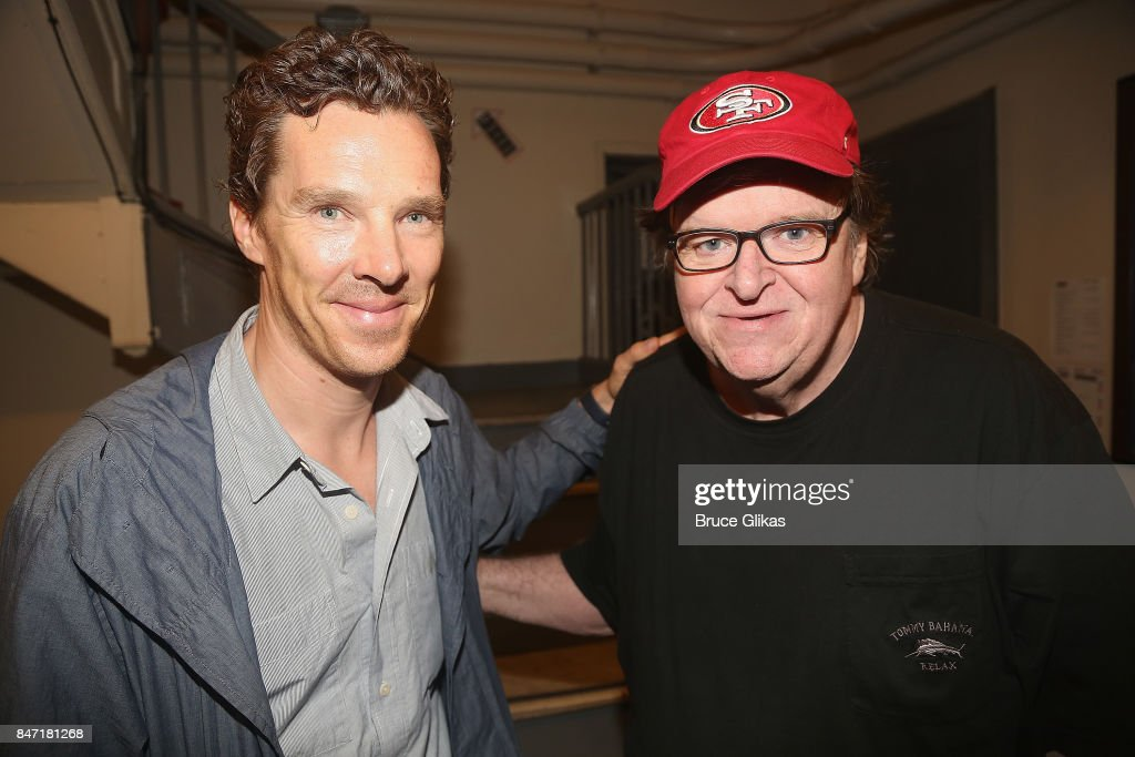 Benedict Cumberbatch and Michael Moore pose backstage at the hit play 'Michael Moore: The Terms of My Surrender' on Broadway at The Belasco Theatre on September 14, 2017 in New York City.