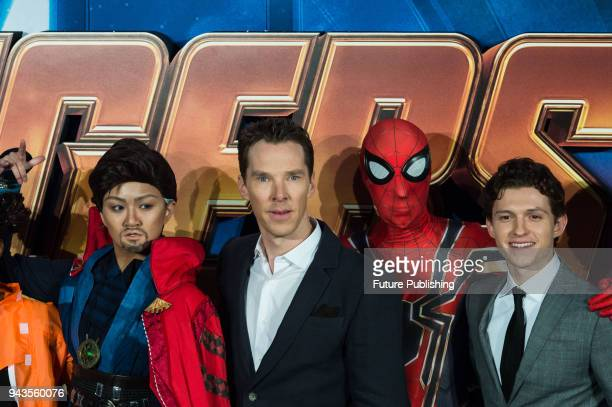 Benedict Cumberbatch and Tom Holland pose with cosplayers at 'Avengers Infinity War' UK fan event at Television Studios in White City in London April...