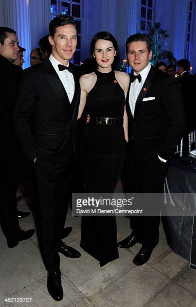 Benedict Cumberbatch Michelle Dockery and Allen Leech attend the Winter Whites Gala in aid of Centrepoint at Kensington Palace on November 26 2013 in...