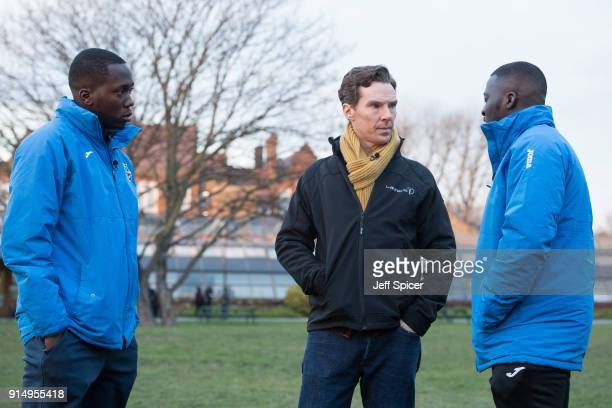 Benedict Cumberbatch pictured with coaches Ibrahim Kanu and Ade Akande visits the Laureus supported Active Communities Network programme at Burgess...