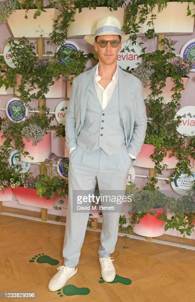 Benedict Cumberbatch poses in evian's VIP suite, certified as carbon neutral by The Carbon Trust, during day eight of The Championships at Wimbledon...