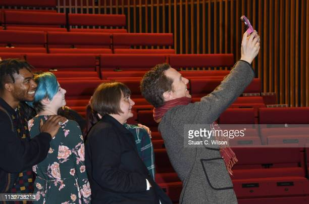 Benedict Cumberbatch poses with drama students after welcoming the new LAMDA Director Sarah Frankcom at LAMDA on February 28 2019 in London England