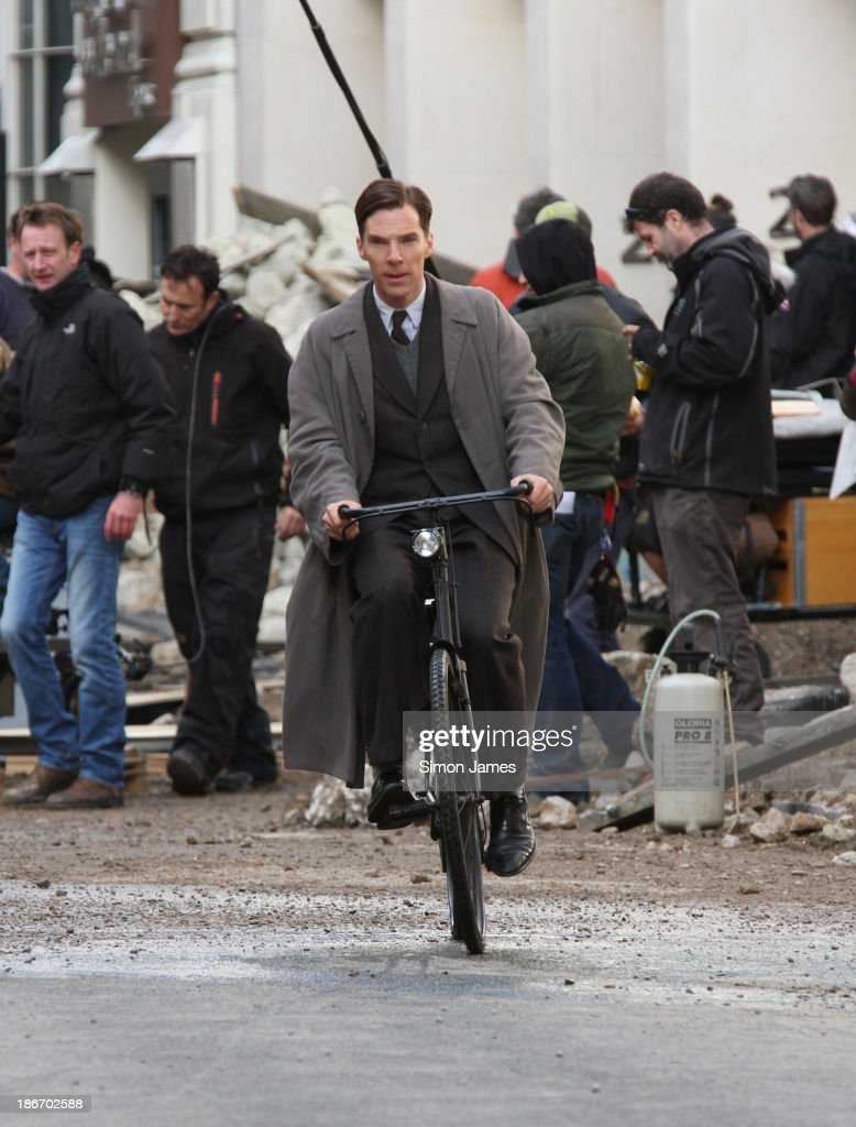Benedict Cumberbatch riding a bicycle filming a scene for 'The Imitation Game' on November 3, 2013 in London, England.