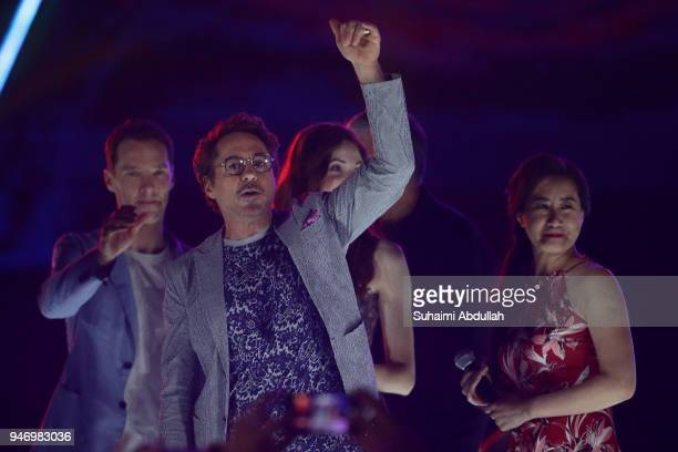 Benedict Cumberbatch Robert Downey Jr and executive producer Trinh Tran attend the Marvel Studios Avengers Infinity War Red Carpet Fan Event at...