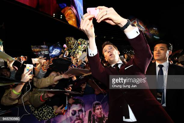 Benedict Cumberbatch takes a selfie with fans at the Seoul premiere of 'Avengers Infinity War' on April 12 2018 in Seoul South Korea