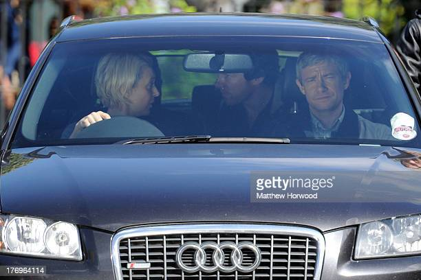 Benedict Cumberbatch with Martin Freeman and Amanda Abbington during filming on the set of BBC production 'Sherlock' on August 18 2013 on Bute Street...