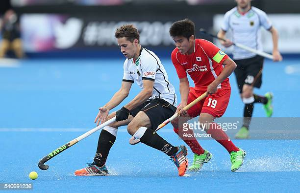 Benedict Furk of Germany and Hyosik You of Korea during the FIH Mens Hero Hockey Champions Trophy match between Korea and Germany at Queen Elizabeth...