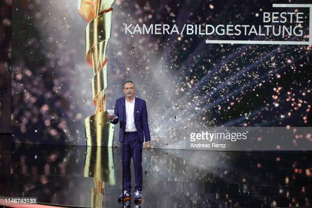 Benedict Neuenfels, winner of best camera, reacts on stage during the Lola - German Film Award show at Palais am Funkturm on May 03, 2019 in Berlin,...