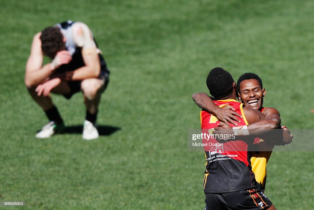 Benedict TIRANG of Papua New Guinea celebrates the win on the siren during the 2017 AFL International Cup Grand FInal match between New Zealand and Papua New Guinea at Melbourne Cricket Ground on August 19, 2017 in Melbourne, Australia.