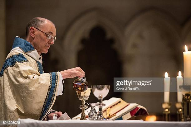 Benedictine monk Abbot Richard Yeo pours the communion wine at mass during a day of reflections on the Jubilee Year of Mercy and before the sealing...
