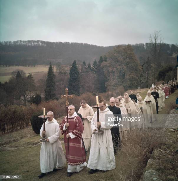 Benedictine monks and members of the congregation walk in procession through the grounds of Prinknash Roman Catholic monastery in Gloucestershire...
