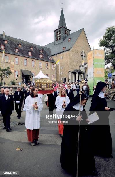 Benedictine nuns and abbess Dorothea Flandera of the abbey 'St Hildegard' walk in front the chest that contains the Eibingen reliquiae treasure as...