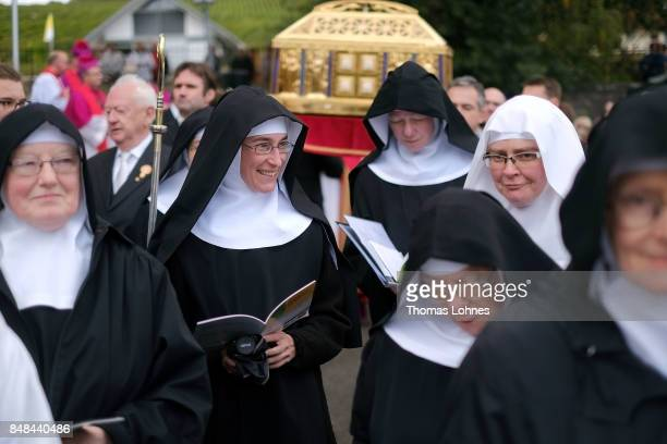 Benedictine nuns from Eibingen Abbey walk in front the chest that contains the Eibingen reliquiae treasure as part of the annual procession during...