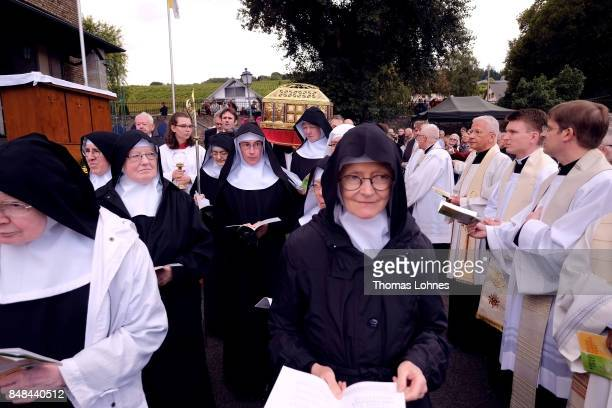 Benedictine nuns of the abbey 'St Hildegard' walk in front the chest that contains the Eibingen reliquiae treasure as part of the annual procession...