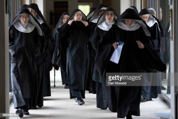 Benedictine nuns process to pray at Stanbrook Abbey on May 8 2017 in Wass England Stanbrook Abbey is located in the North Yorkshire Moors National...