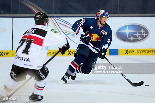 Benedikt Brueckner of Muenchen is challenge by Andreas Falk of Koeln during the DEL Ice Hockey match between EHC Red Bull Muenchen and Koelner Haie...