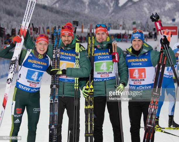 Benedikt Doll, Arnd Peiffer, Johannes Kuehn and Simon Schempp of Germany celebrate after the IBU Biathlon World Cup Men's 4x7.5 km Relay on December...