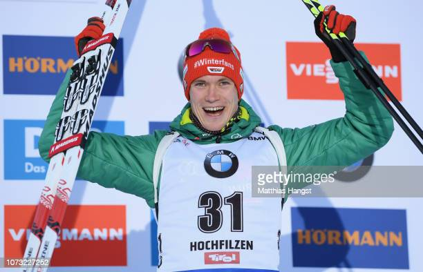 Benedikt Doll of Germany celebrates finishing in third place after the Men's 10km Sprint during the IBU World Cup at the Biathlon Stadium Hochfilzen...
