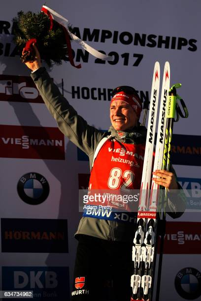 Benedikt Doll of Germany celebrates winning the gold medal in the men's 10km sprint competition of the IBU World Championships Biathlon 2017 at the...