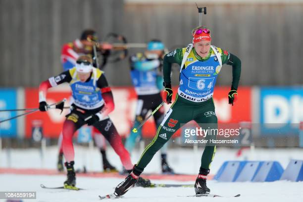 Benedikt Doll of Germany leave the shooting range after the last shooting ahead of Johannes Thingnes Boe of Norway during the Men 4x7.5 km Relay...