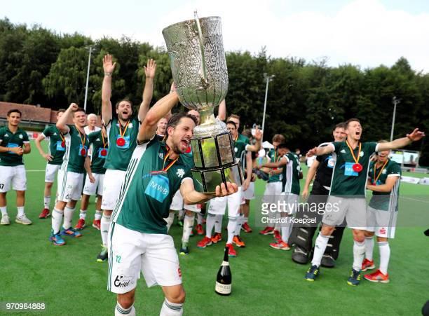 Benedikt Fuerk of HTC Uhlenhorst Muelheim lifts the trophy after winning 32 the mens final match between RotWeiss Koeln and HTC Uhlenhorst Muelheim...